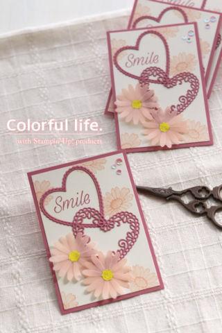 ピンクデイジーのガーリーなカード(縦:デイジーレーン)