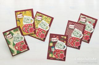 キュートなカップを重ねたクリスマスカード:暖色系(横:カップ・オブ・クリスマス)