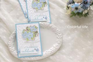 お花を飾って♪お祝いケーキのカード(横:ハッピーバースディ・トゥーユー)