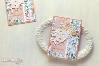 キュートなオレンジ色でダイカットのパーツをはめ込んだ、ブーケのカード(横:HAND-PENNED/スタンピンアップ)