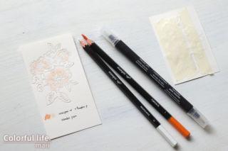 キュートなオレンジ色でダイカットのパーツをはめ込んだ、ブーケのカード(ダイカットパーツ)